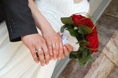 wedding flower in a bride and groom hands Stock Photos