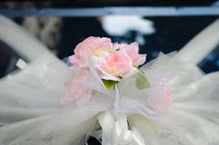 Wedding flower on car. Flower in front of wedding car Royalty Free Stock Photo