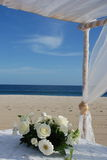 Wedding Flower center piece. Wedding flower bouquet in white on the beach of Costa Azul Los Cabos a favourite Mexican Wedding Destination stock photo