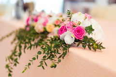 Wedding flower decoration. On the table Royalty Free Stock Photo