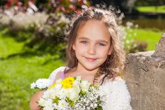 Wedding - Flower Girl. In a beautiful rosa dress royalty free stock images