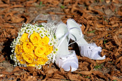 Wedding flower and shoes. Wedding flower and white shoes between leaves Stock Photography