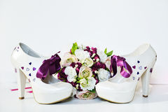 Wedding flower and shoes. On the table Stock Photo