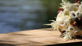 Wedding flower in sunlight in the background of the water stock video