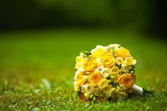 Wedding flower. Yellow Wedding flower on the grass with two rings Stock Images