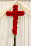 Wedding flowers. Picture of beautiful red roses decorated into shape of Cross on a christian wedding ceremony Stock Photography