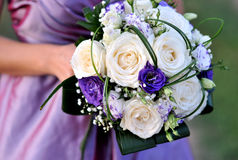 Wedding flowers. White wedding roses with purple and green Royalty Free Stock Image