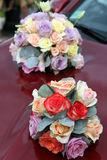 Wedding flowers. Beautiful colorful weeding flowers on car Royalty Free Stock Images