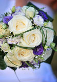 Wedding flowers. White wedding roses with purple and green - copy space Stock Images