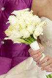 Wedding flowers. Bouquet of white flowers in bride's hands Royalty Free Stock Image