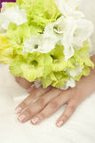 Wedding flowers. Bouquet of white flowers in bride's hands Stock Photo