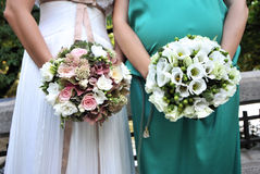 Wedding flowers. Woman hands holding wedding flowers in different colours - copy space Stock Image