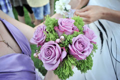 Wedding flowers. Woman hands holding purple wedding flowers Royalty Free Stock Image