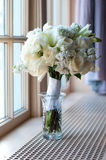 Wedding Flowers. Bridal Bouquet sitting next to a window Stock Images