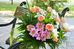 Wedding flowers. On seat, outdoor Stock Photo