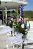 Wedding Flowers. Flower arrangements on the pews at a wedding Stock Photos