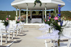 Wedding Flowers. Flower arrangements on the pews at a wedding Royalty Free Stock Photo