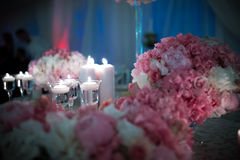 Wedding flowers. Wedding bouquet and candle on the bride and groom's table Stock Images
