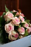 Wedding flowers. Pink roses in a box Stock Image