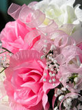 Wedding flowers. A bouquet of artificial pink and white flowers and ribbon Royalty Free Stock Photography