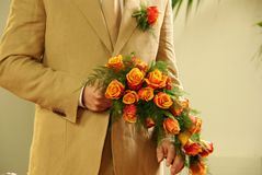 Wedding flowers. The groom waits with a bouquet of wedding flowers Royalty Free Stock Image