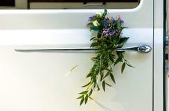 Wedding flowers. On car door Stock Photos