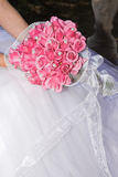 Wedding Flowers. Wedding Bouquet with pink roses and pearly beads Stock Photos