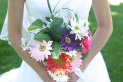 Wedding flowers. Bride holding wedding flowers Royalty Free Stock Image