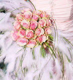 Wedding flowers. Bride is holding wedding bouquet royalty free stock images