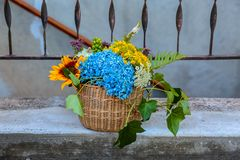 Wedding flowers basket basket standing on a porch of a house royalty free stock photos