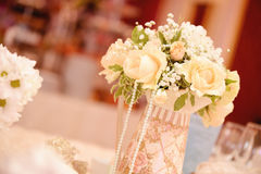Wedding flowers. Beautiful white roses on wedding table Stock Photos