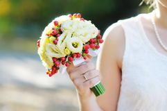 Wedding flowers bouquet. Bride holding beautiful wedding flowers bouquet Stock Image