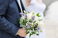 Wedding flowers bouquet. Groom holding beautiful wedding flowers bouquet Royalty Free Stock Image
