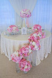 Wedding flowers. Wedding bouquet on the bride and groom's table Royalty Free Stock Images