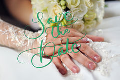 Wedding Flowers Bouquet in Bride Hands with White Dress on Background and words Save the Date. Calligraphy lettering Royalty Free Stock Photos