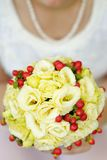 Wedding flowers bouquet. Bride holding beautiful wedding flowers bouquet Royalty Free Stock Image