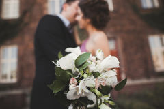 Wedding flowers bouquet with newlywed couple on background Royalty Free Stock Photo