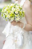 Wedding flowers bouquet. Woman holding beautiful wedding flowers bouquet Royalty Free Stock Photos