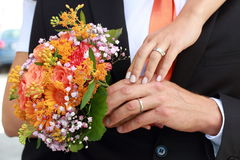 Wedding flowers bouquet. Young couple with wedding flowers bouquet Stock Image