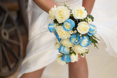 Wedding flowers - bridal bouquet. A bridal bouquet of blue and white flowers. Roses and foliage Stock Photos