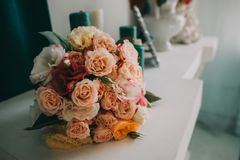 Wedding flowers, bridal bouquet closeup. Decoration made of roses, peonies and decorative plants, close-up, selective. Focus, nobody, objects Stock Image