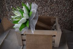 A hand made and tied posy is a fairly tightly formed bouquet, perfect for a bride who likes simple clean lines with minimal fuss. Wedding flowers for the bride Royalty Free Stock Photos