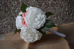 A hand made and tied posy is a fairly tightly formed bouquet, perfect for a bride who likes simple clean lines with minimal fuss. Wedding flowers for the bride stock photography