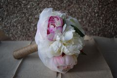 A hand made and tied posy is a fairly tightly formed bouquet, perfect for a bride who likes simple clean lines with minimal fuss. Wedding flowers for the bride royalty free stock photo