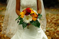 Wedding Flowers on Bride's Hand Stock Photos