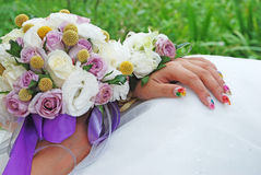 Wedding flowers in the bride's hands Stock Images