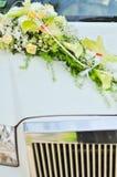 Wedding flowers on car. Beautiful wedding flowers on white luxury car Stock Image