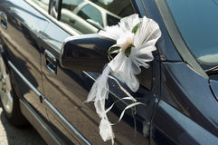 Wedding flowers on a car mirror Stock Image