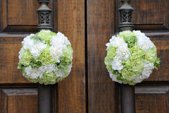 Wedding  flowers on the church door Royalty Free Stock Images