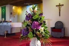 Wedding flowers in Church. Wedding flowers set up in catholic church Royalty Free Stock Photo
